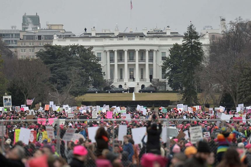 Demonstrators protest near the White House in Washington, DC, for the Women's March on Jan 21, 2017.