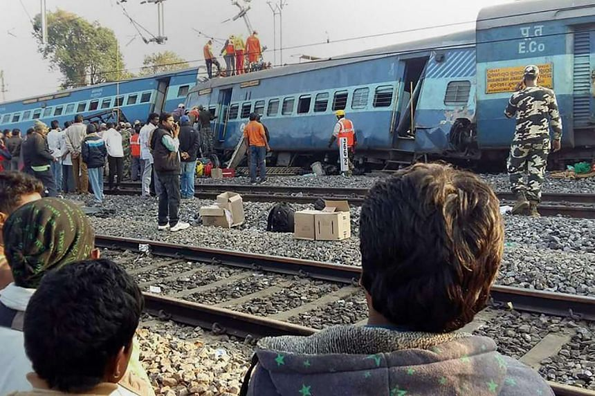 Rescue workers look for survivors at the site of the derailment of the Jagdalpur-Bhubaneswar express train near Kuneru station in southern Andhra Pradesh state on Jan 22, 2017.