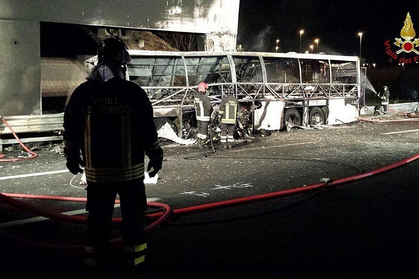 A photo by Vigili del Fuoco (Italian Firewatchers) shows the burnt-out bus after the accident. The vehicle smashed into a bridge pillar on a motorway near Verona on Friday night and was engulfed by a huge inferno.