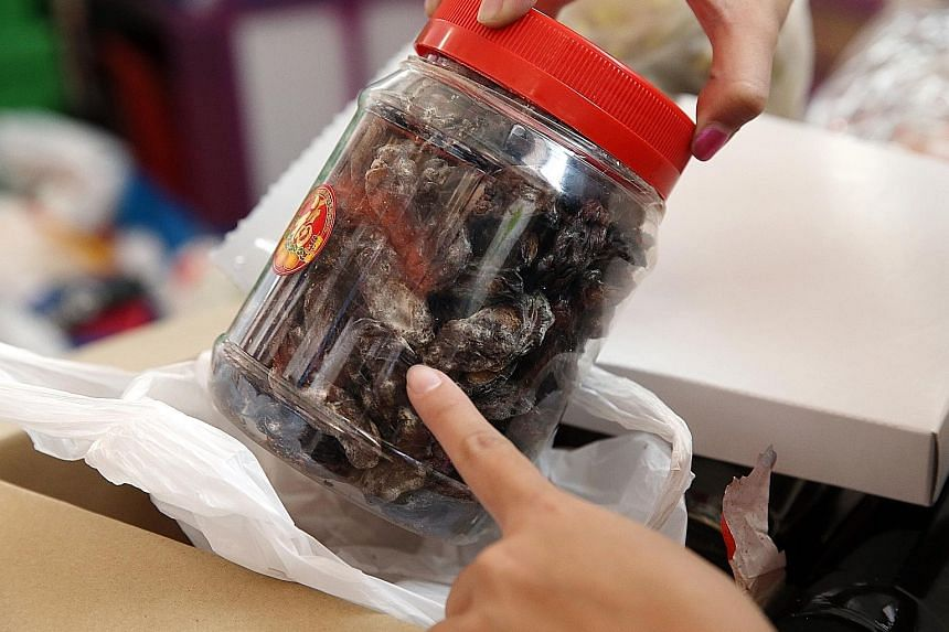 This container of mouldy dates was found in a box of donations at The Food Bank Singapore. The charity discards about 10 to 20 per cent of the 240 tonnes of food that it receives each year.