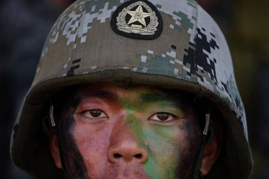 A People's Liberation Army (PLA) of China soldier looks on after participating in an anti-terror drill during the Sixth India-China Joint Training exercise.
