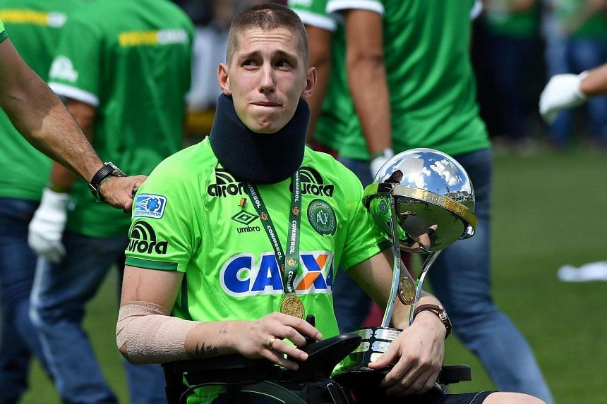 Brazilian Chapecoense goalkeeper Jackson Follmann, a survivor of the LaMia airplane crash in Colombia, holds the Copa Sudamericana trophy at the Arena Conda stadium in Chapeco.