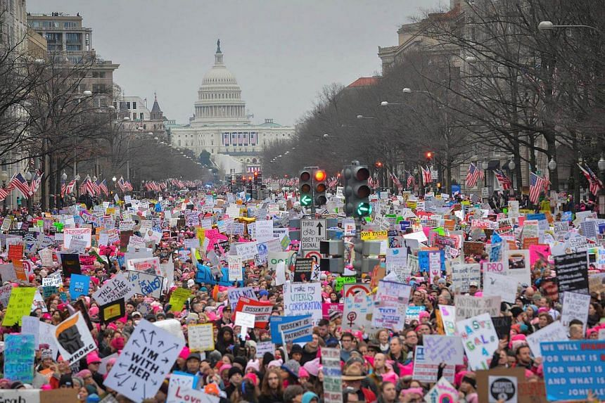 Hundreds of thousands march down Pennsylvania Avenue during the Women's March in Washington, DC.