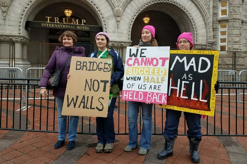 Protesters with messages for new US President Donald Trump in Washington on Jan 21, 2017.
