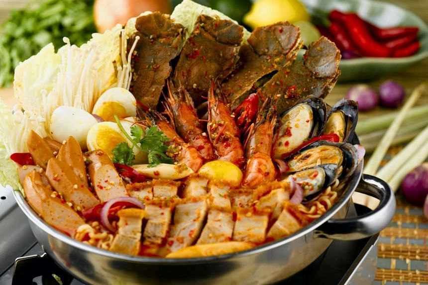 The signature Royal Thai Hot Pot ($38.80 for two, $68.80 for four, above) features ingredients such as crayfish, tiger prawns and roasted pork, served in a housemade tom yam broth.