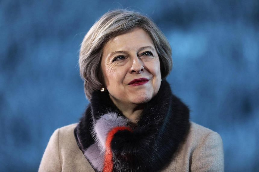 Theresa May reacts during a Bloomberg Television interview at the World Economic Forum (WEF) in Davos, Switzerland.