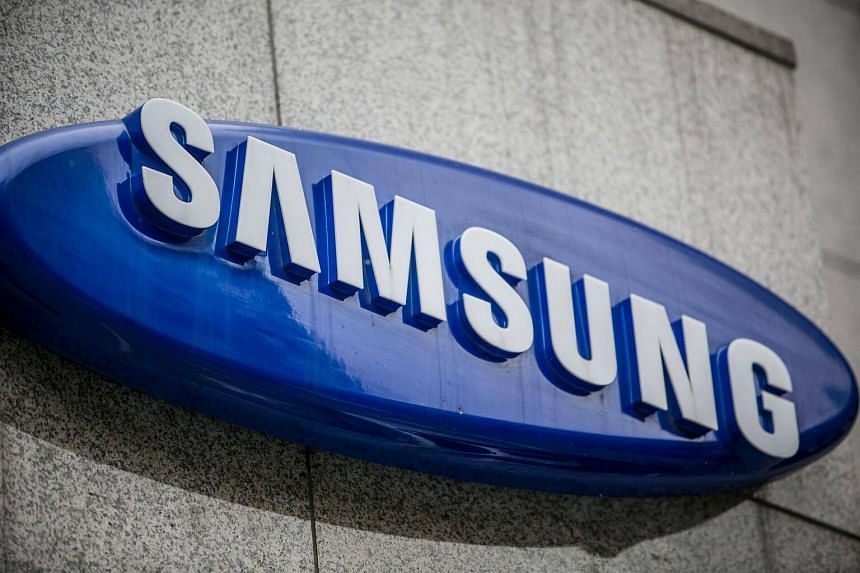 A logo for Samsung Electronics Co. is displayed atop the entrance to a store in Seoul, South Korea.