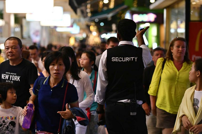 A security personnel making rounds in Orchard Road.