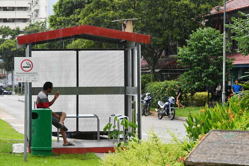 A smoker at a designated smoking point near Block 846, Yishun Ring Road, on Jan 22, 2017. Nee Soon South grassroots organisations have built 42 designated smoking points near coffee shops and Housing Board blocks.