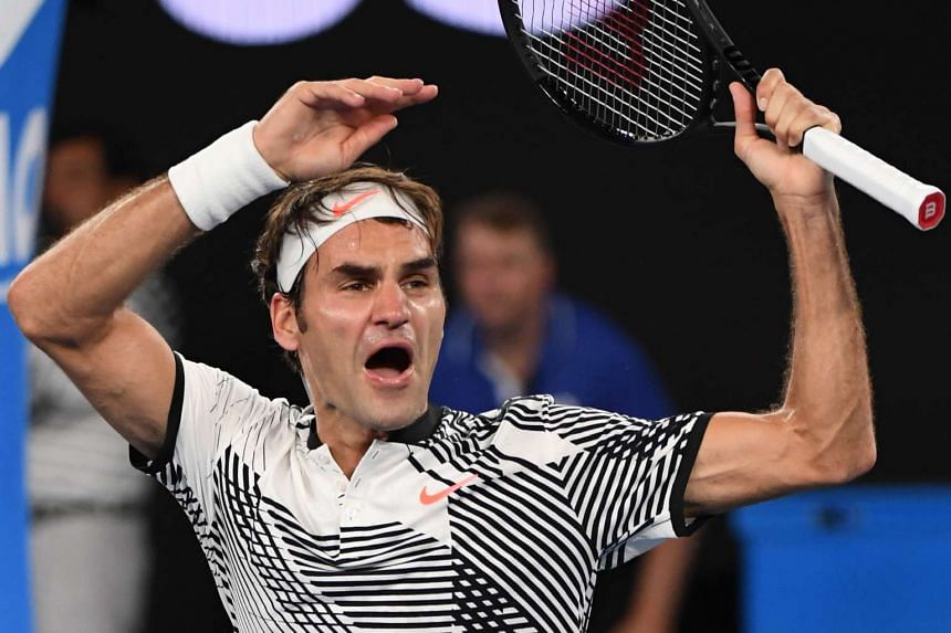 Switzerland's Roger Federer celebrating his victory against Japan's Kei Nishikori during their men's singles fourth round match on day seven of the Australian Open tennis tournament in Melbourne on Jan 22, 2017.