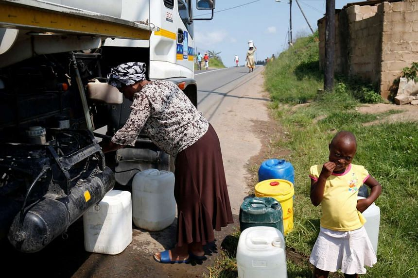 Residents of Ntuzuma collect water from a truck after cuts in water supply were made due to persistent drought conditions, in Durban, South Africa, on Jan 22, 2017.