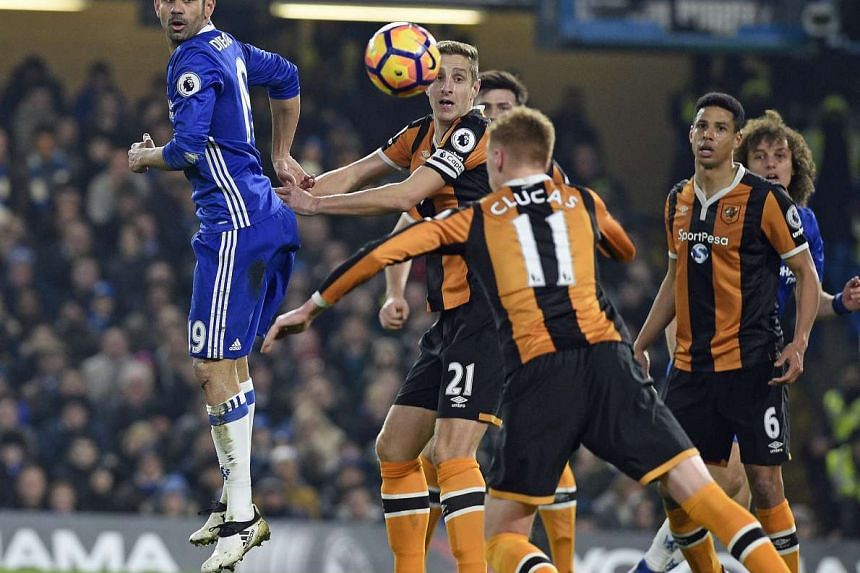 Chelsea's Diego Costa (left) vies for the ball with Hull City's Sam Clucas (11) during the English Premier League soccer match between Chelsea FC and Hull City at Stamford Bridge, London, Britain, on Jan 22, 2017.