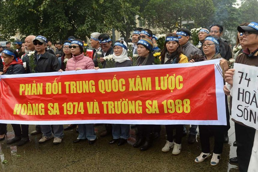 Activists at a rally marking the 42nd anniversary of the naval battle between China and then-South Vietnamese troops over the Paracel Islands in the South China Sea.