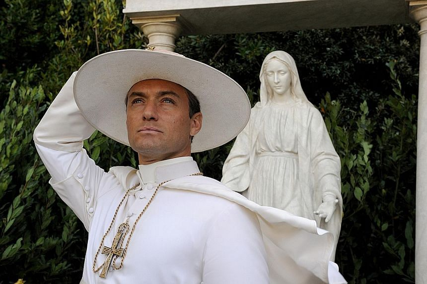 British actor Jude Law (above) plays a pope in the unlikeliest role of his career.