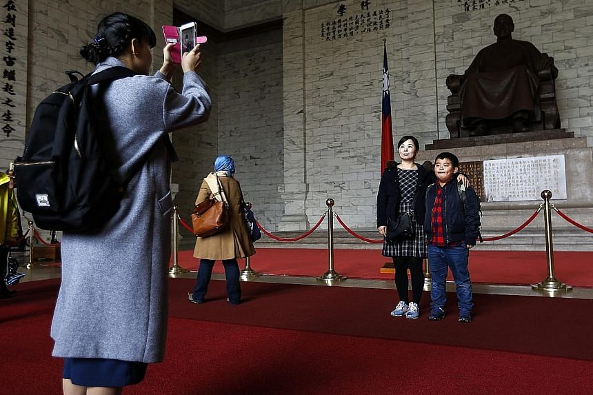 Tourists at Chiang Kai-shek Memorial Hall in Taipei earlier this month.