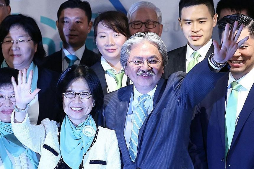 Mr Tsang and his wife, Lynn, at the press conference to announce his candidacy last week. The Harvard-educated former financial secretary has consistently been the front runner in opinion polls about the public's choice for chief executive.