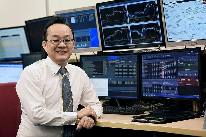 Phillip Securities executive director Mr Lim with the Poems Mercury, a new trading platform, which sports features such as multi-screen, dual-language support.