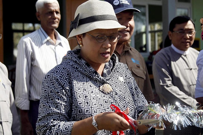 Indonesian Foreign Minister Retno Marsudi cutting the ribbon during the opening of a new school building donated by the Indonesian government in Sittwe, Rakhine state, in Myanmar on Saturday. In her third visit to the country in recent months, Ms Ret