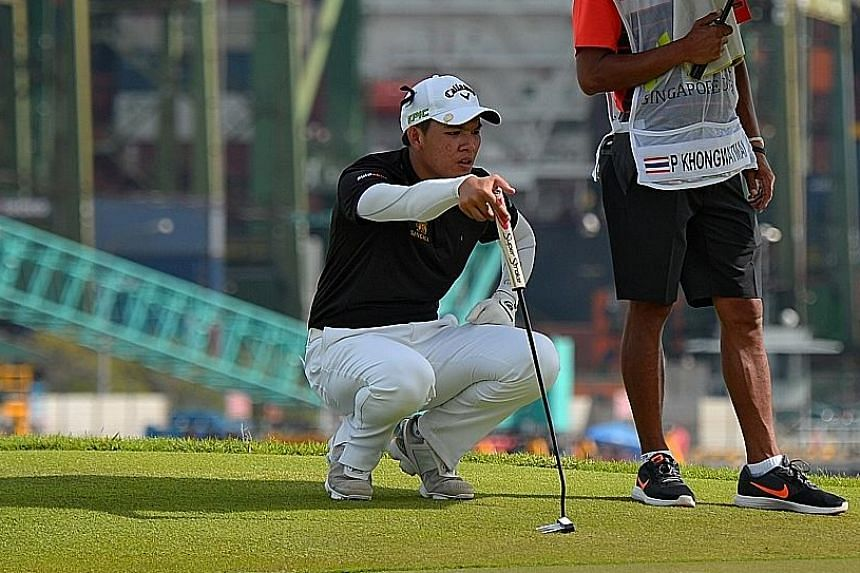 Phachara Khongwatmai lining up a shot at the Serapong course, before finishing tied-second at the Singapore Open which concluded yesterday. The 17-year-old is one of a new wave of golfers from his country looking to rise through the ranks.