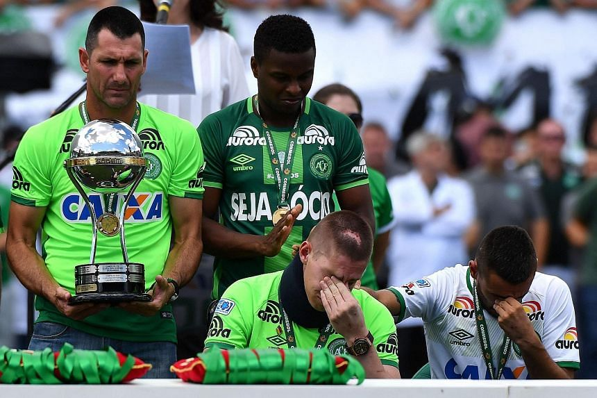 Above left: Chapecoense's 'new-look' team line up before the friendly game against Palmeiras. Above: Chapcoense players who survived the tragedy Jackson Follmann and Alan Ruschel (bottom row) before the game.