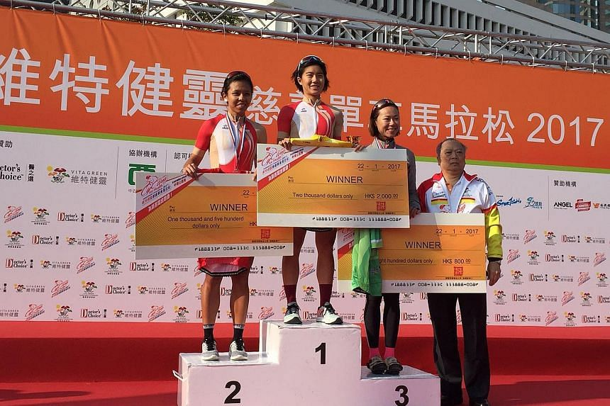 Singapore's cyclists Serene Lee (centre) and Luo Yiwei (left) posted a one-two finish in the Elite Female 1 criterium race at the Vita Green Cycling for Health Marathon Challenge held in Hong Kong yesterday.