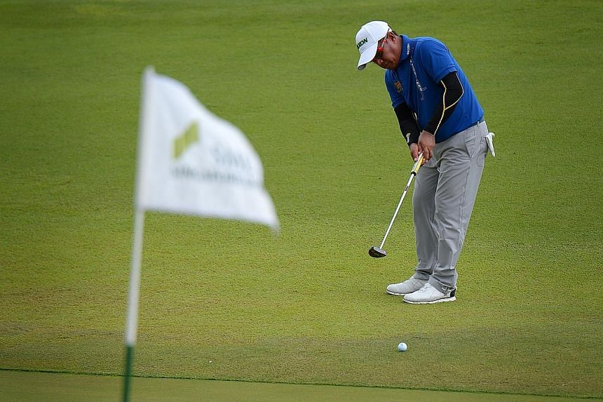 Thailand's Prayad Marksaeng putting at the Sentosa Golf Club's 18th hole, where his Singapore Open win made him the competition's oldest winner.