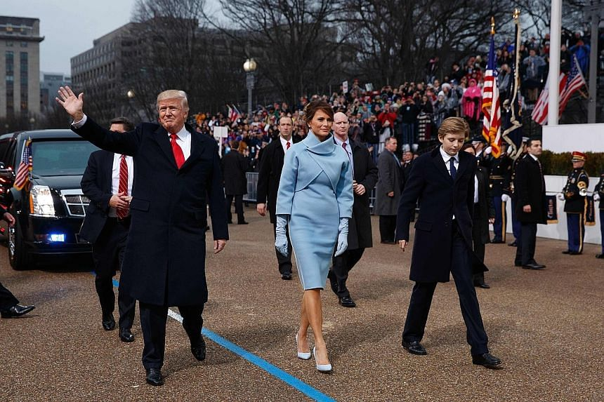 President Trump, his wife Melania and their son Barron during the inauguration parade in Washington last Friday. The writer says no one should underestimate Mr Trump, who published The Art Of The Deal in 1987, but MAGAlomania alone will not be enough