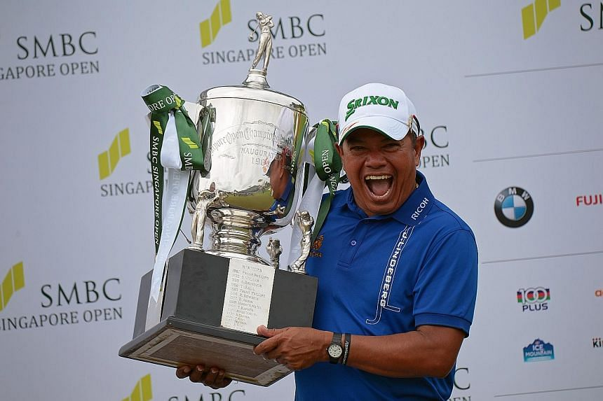 Prayad Marksaeng showing off his trophy after winning the SMBC Singapore Open yesterday. At 50, the Thai golfer is the oldest winner of the US$1 million (S$1.43 million) tournament. SEE SPORT C11