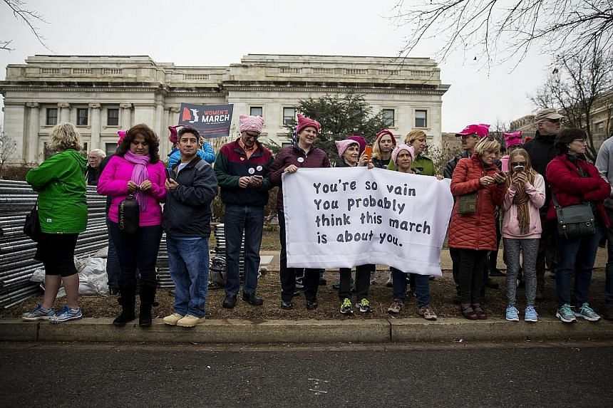 Women's March participants took to the streets in cities around the world last Saturday, including Berlin (right) and Washington (above), where the turnout was at least double that at last Friday's presidential inauguration. Speakers and marchers cam