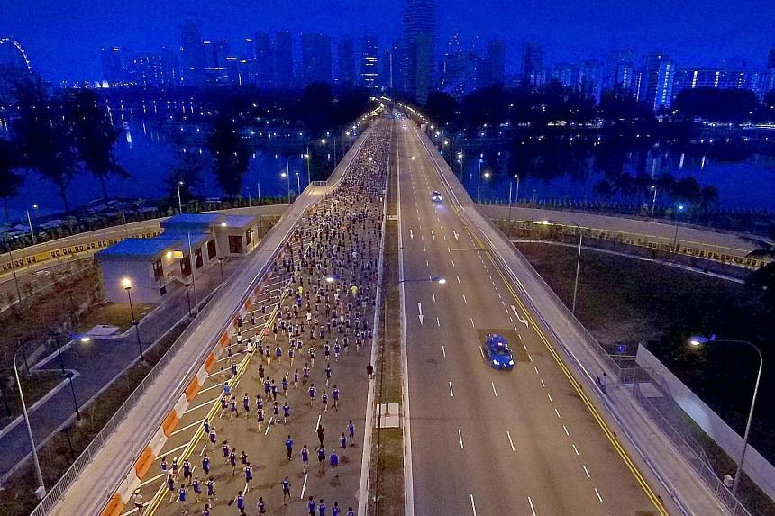 Runners taking part in the ST Run at the Hub in 2015. This year's event will again take runners past some of Singapore's most iconic landmarks and, with the race ending at the Padang, parts of the Civic District will also feature.