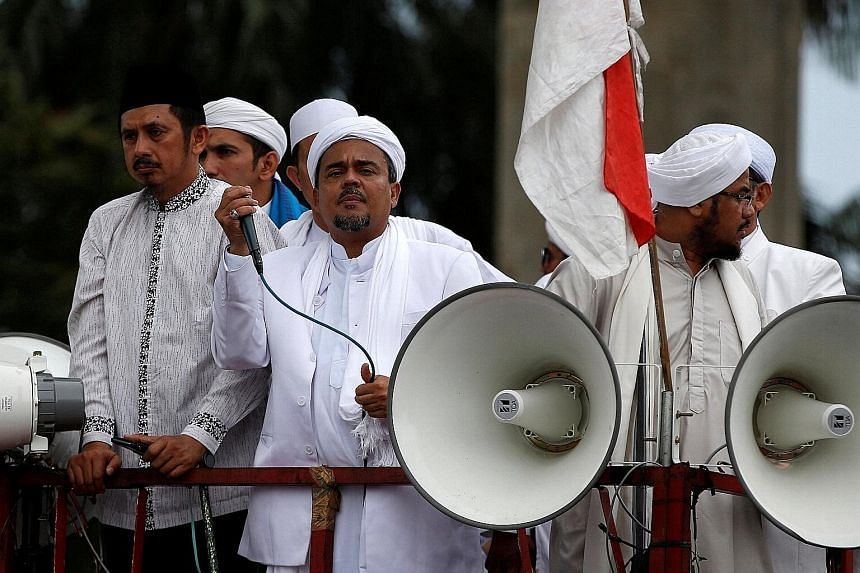 Mr Rizieq (with microphone) leading a protest outside the National Police headquarters in Jakarta last week, in which he called for a provincial police chief to step down over what the FPI says was police violence against its members.