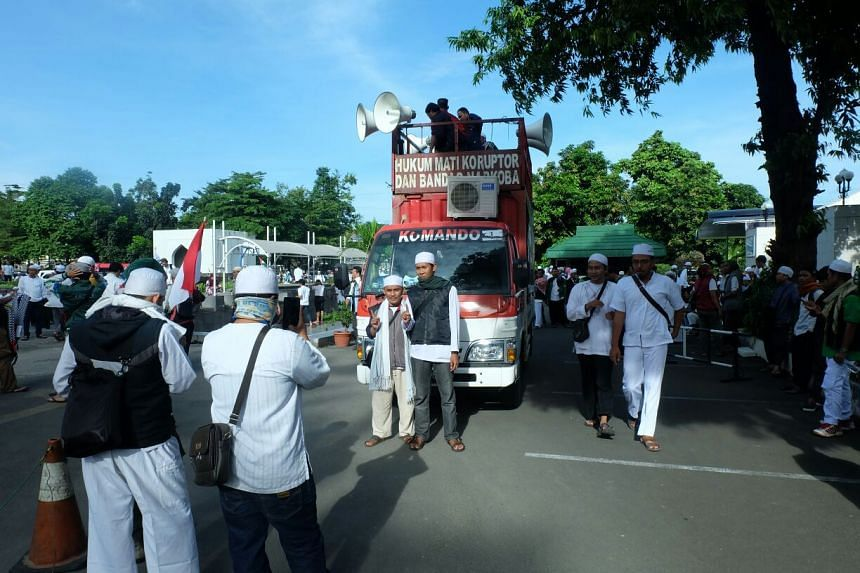 Members of the Front Pembela Islam (FPI), or Islamic Defenders' Front, and other Muslim hardline groups, gathering at the Al-Azhar mosque for a street march to protest against the police for investigating FPI leader Habib Rizieq Shihab.
