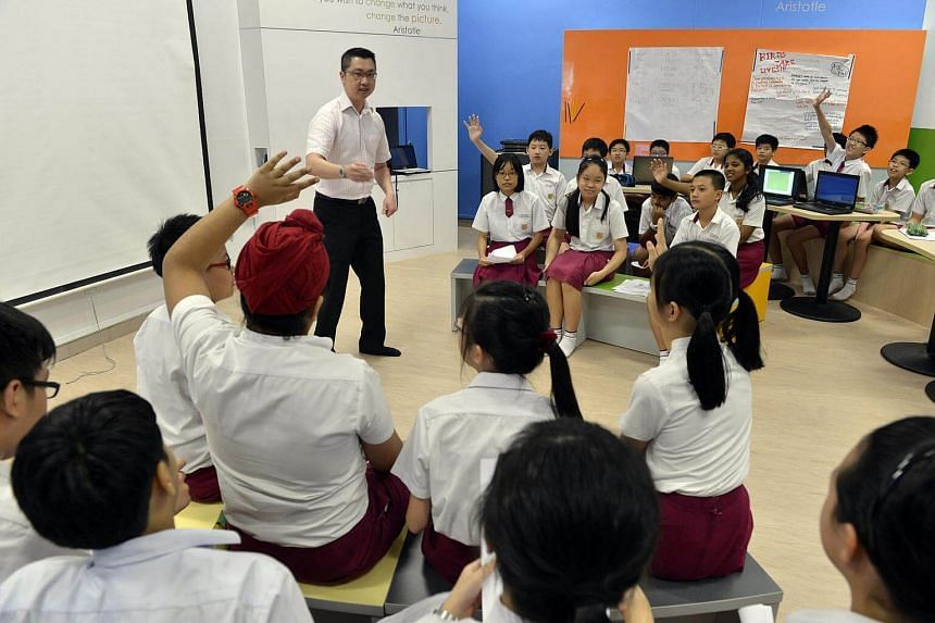 Teacher Anthony Tan conducting an English lesson with a class of Primary 6 pupils at Woodlands Primary School.