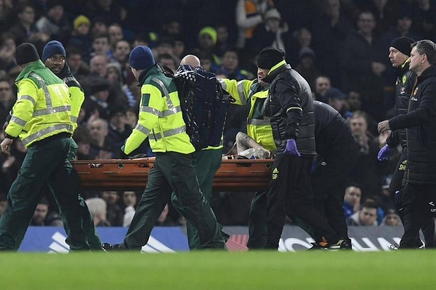 Hull City's Ryan Mason (centre) is taken off the pitch by medical teams after a collision with Chelsea's Gary Cahill on Jan 22, 2017.
