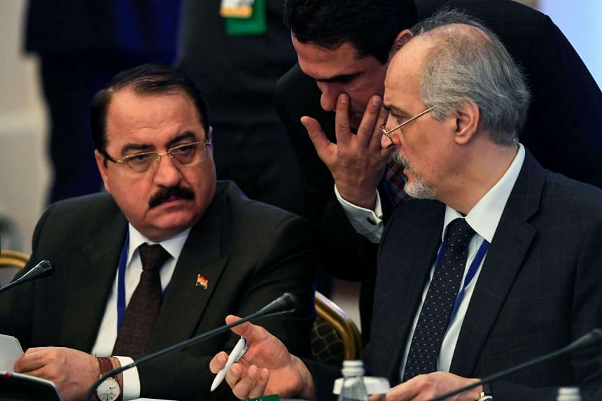 Syria's UN ambassador and head of the regime delegation Bashar al-Jaafari (right) speaking with Syrian ambassador to Russia Riad Haddad prior to the first session of Syria peace talks.