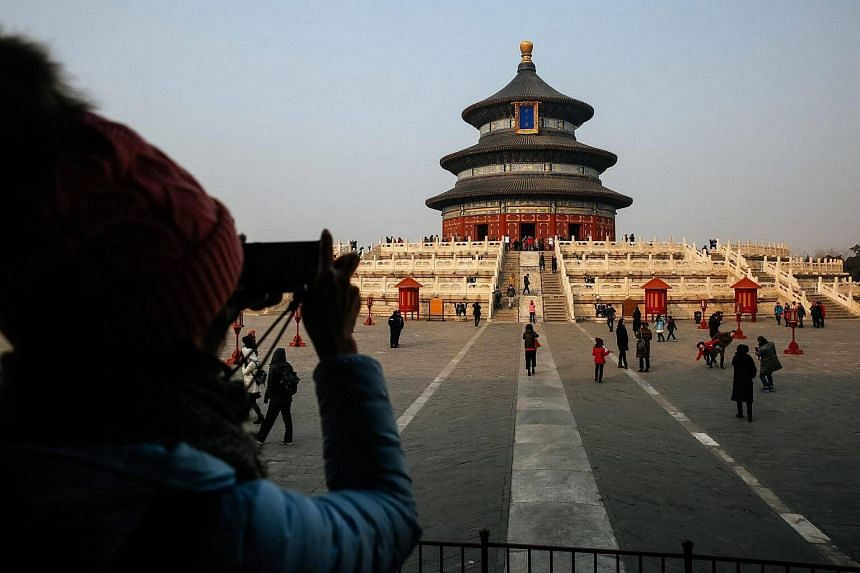 A person takes a photo of the compound of the Hall of Prayer for Good Harvests at the Temple of Heaven in Beijing, China on Jan 17, 2017.