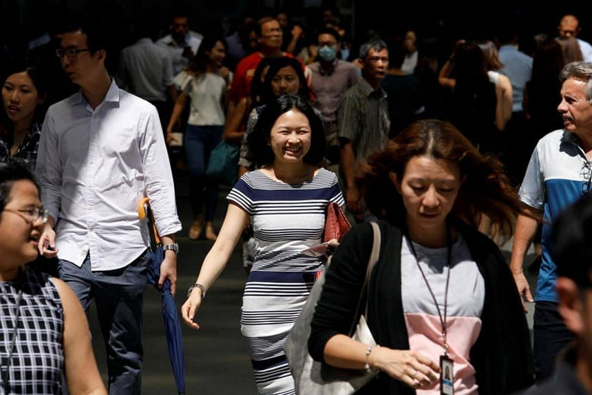 Office workers head for lunch at the central business district (CBD) in Singapore on Jan 6, 2017.