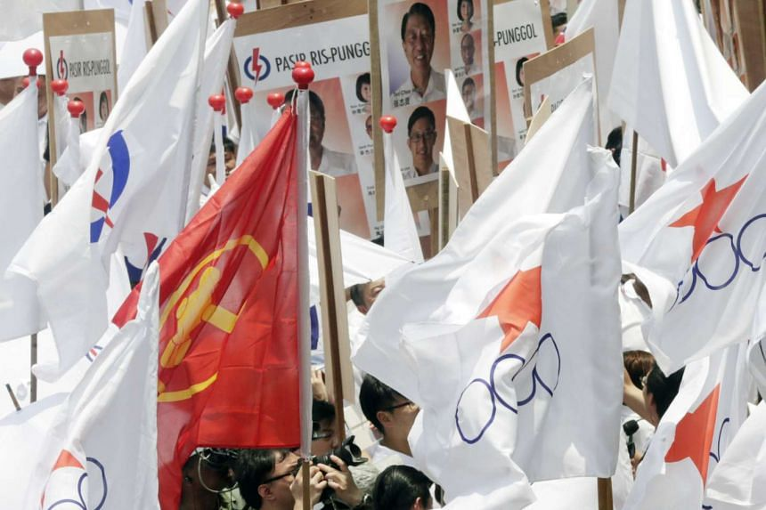 Supporters of People's Action Party (PAP), Workers' Party (WP) and Singapore Democratic Alliance (SDA) with their party flags as they gathered at Fengshan Primary School on Sept 1, 2015.