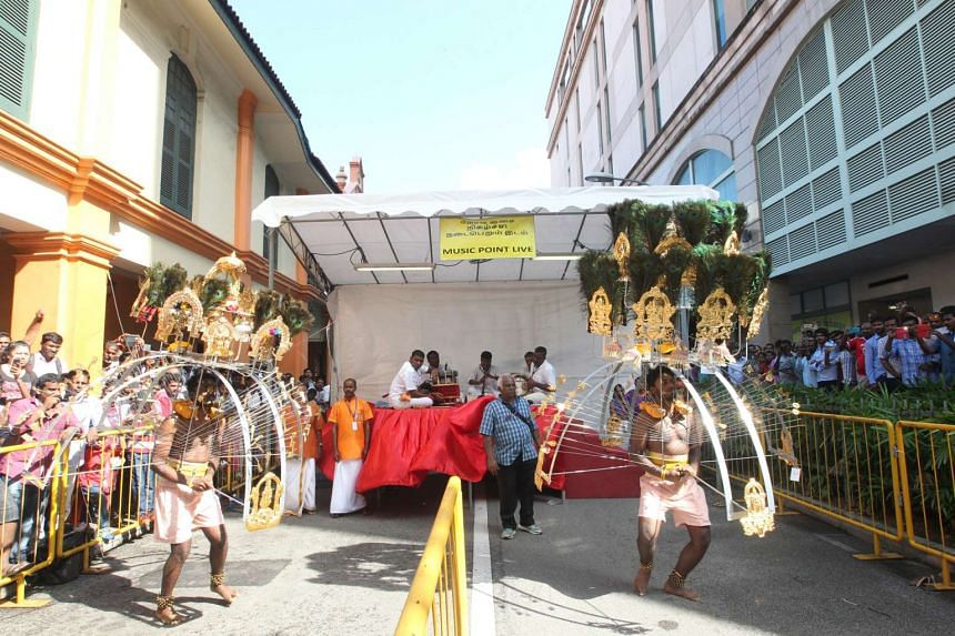 Devotees carrying kavadis during the Thaipusam festival in Singapore last year. This year, music will be broadcast at 23 points along the route.