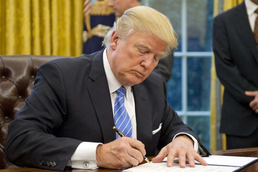 President Donald Trump on Monday signed an executive order ending US participation in the TPP, a free trade pact signed by 12 countries - including Singapore - that together account for 40 per cent of world trade.