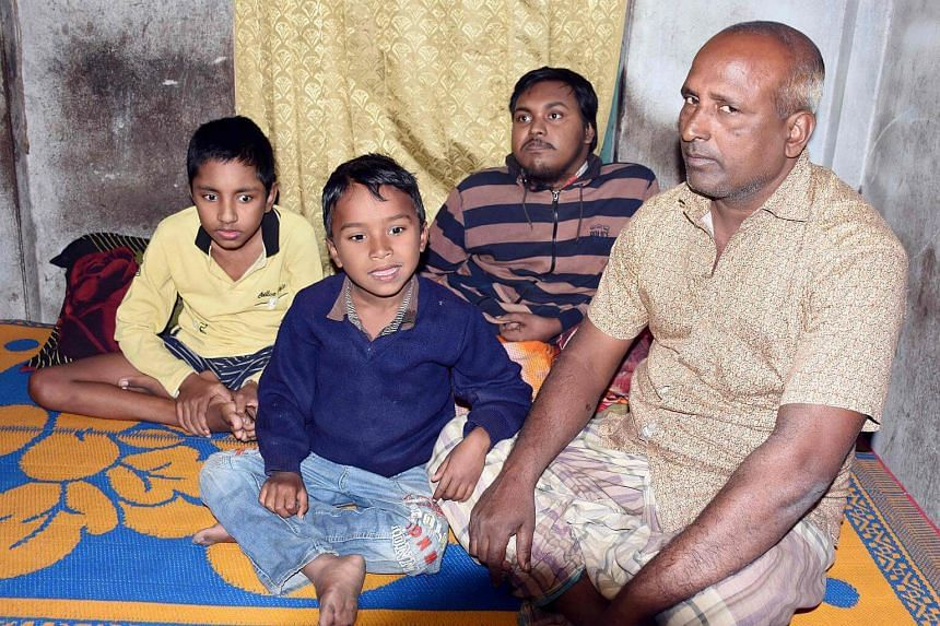 Bangladeshi father and fruit vendor Tofazzal Hossain (right), who has sparked a debate over assisted suicide, is seen with his two sons and grandson (second from left) in Meherpur on Jan 20, 2017.