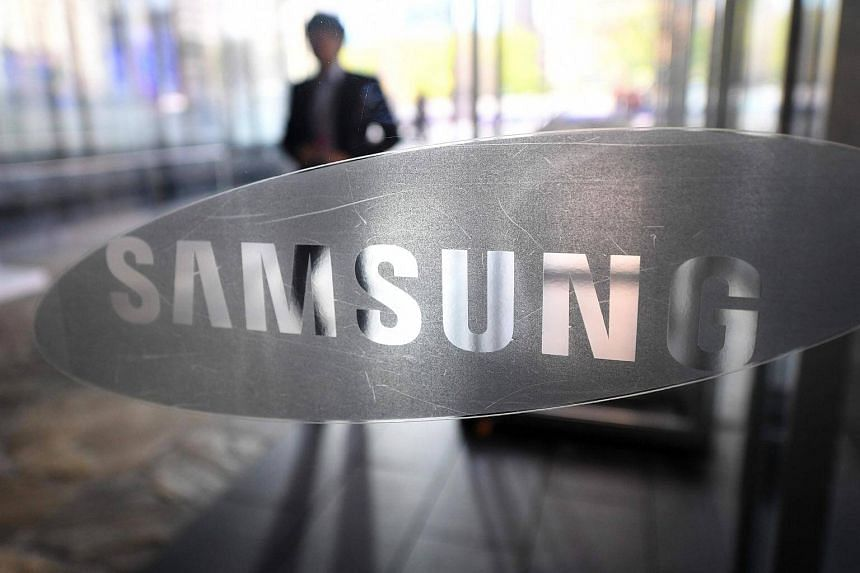 A man walking past the logo of Samsung Electronics at a flagship store in Seoul, on Oct 27, 2016.