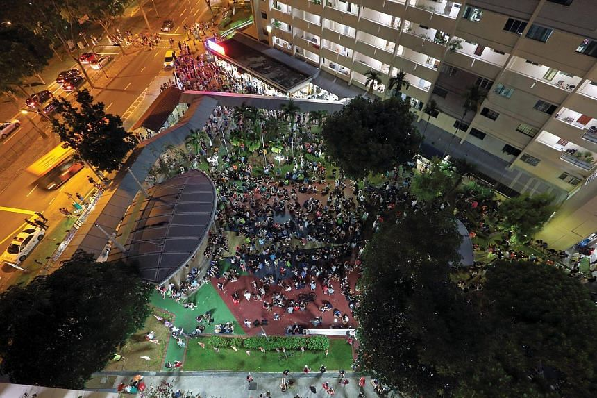 Pokemon Go players crowding in front of Block 401, Hougang Avenue 10, in August last year. South Korea may soon see scenes like this, with the game launching in the country on Tuesday, Jan 24, 2017.