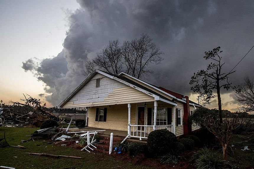A damaged home near where several people were killed in Georgia.
