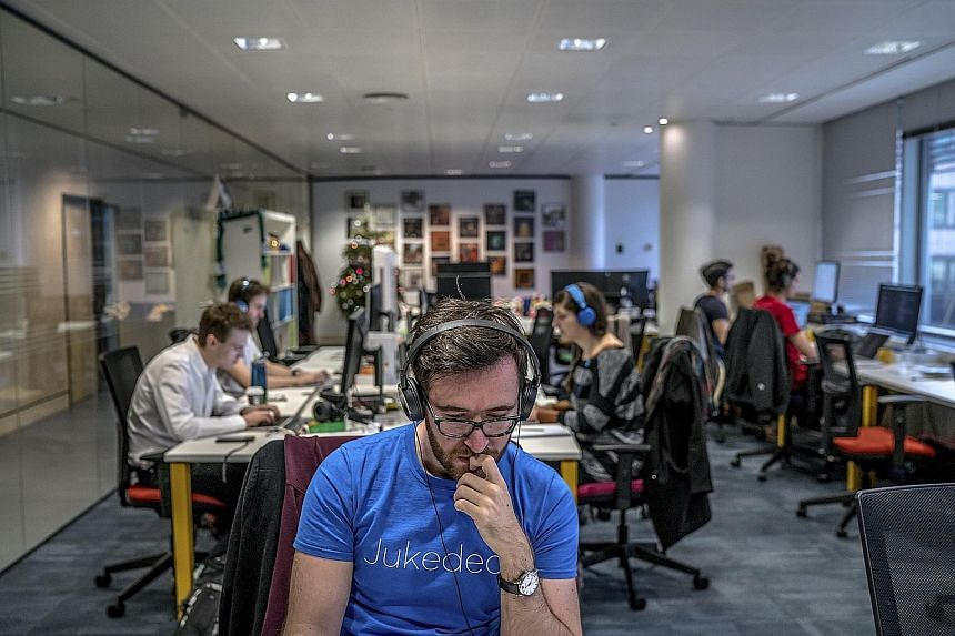 Employees in the London office of Jukedeck (above), which is founded by composer Ed Newton-Rex and Mr Patrick Stobbs.