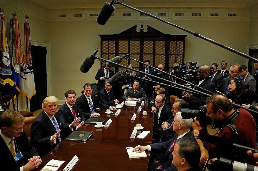 Mr Trump holding a meeting at the White House yesterday with corporate chief executives, including (from far left) Corning's Mr Wendell Weeks, Johnson & Johnson's Mr Alex Gorsky, Dell's Mr Michael Dell and US Steel's Mr Mario Longhi. The meeting took