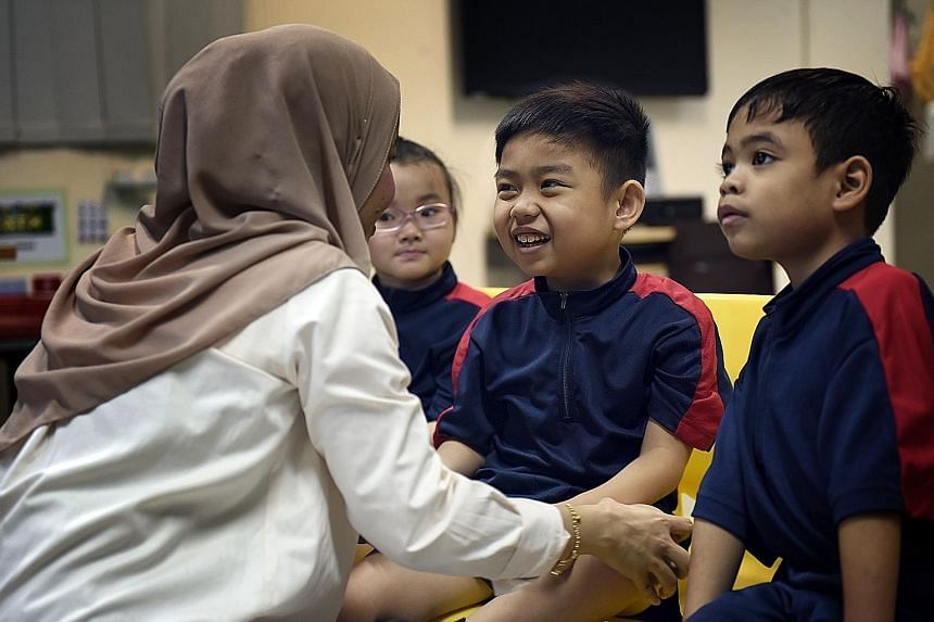 Nabil (second from right) enjoying his lessons at Minds Woodlands Gardens School. He was put on the wait list for one year by Eden School, which is autism-specific. Minds caters to students with other disabilities as well.