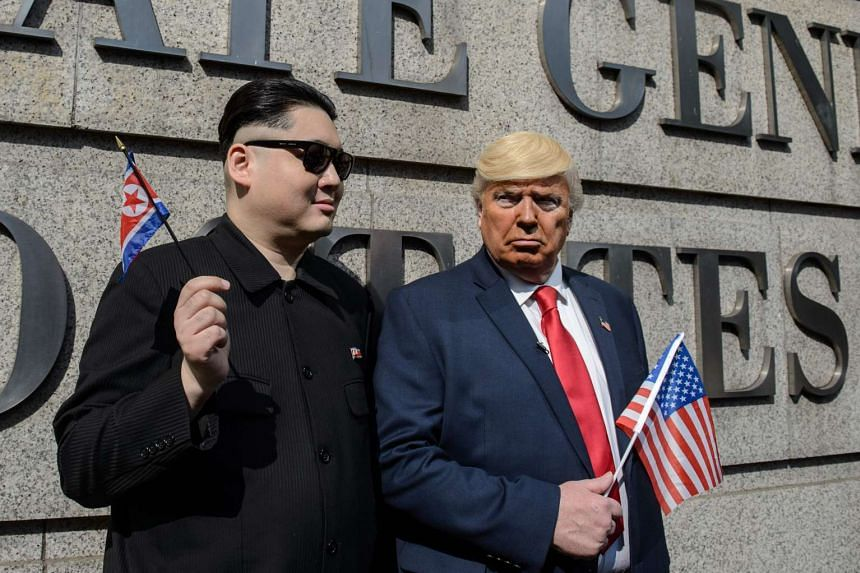 Hong Kong actor Howard (left), impersonating North Korean leader Kim Jong Un, and US actor Dennis, impersonating US President Donald Trump, pose outside the US consulate in Hong Kong on Jan 25, 2017.