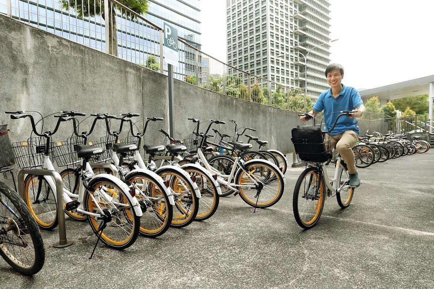 Life science researcher Wang Jun Xia, trying out one of the new oBike's at Buona Vista MRT station on Jan 20, 2017.