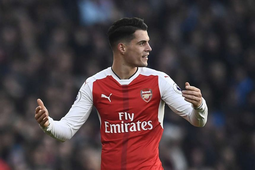 Arsenal's Granit Xhaka has been interviewed by police over an allegation he racially abused a staff member at London's Heathrow Airport on Monday (Jan 23).